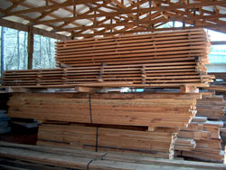 Red oak boards stick stacked for air-drying.